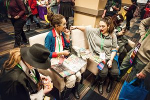 Attendees compare trading cards in the BroadwayCon Marketplace
